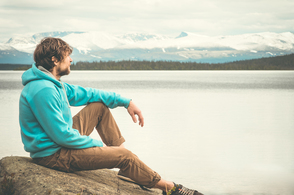 Picture of Young man looking out at a lake to accompany our disability page