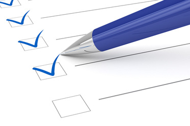 Image of a pen checking off boxes on a checklist