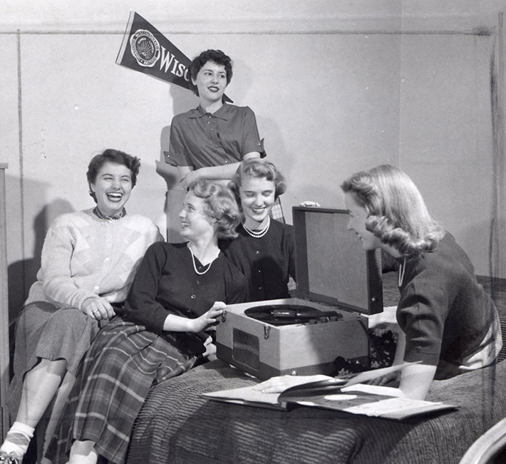 Picture: black & white 1950's photo of college women around a record player